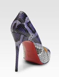 Talpa rosie a pantofilor Louboutin, din nou marul discordiei